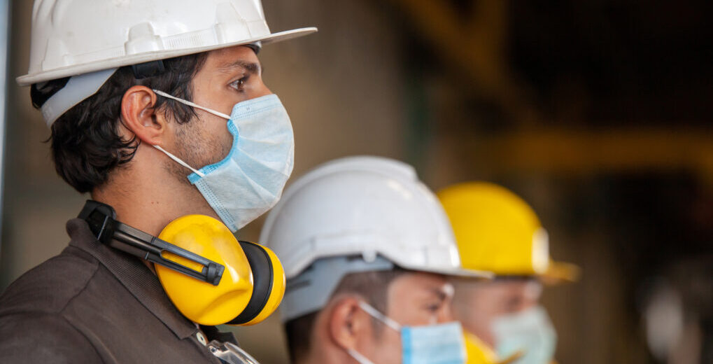 Workers wear protective face masks for safety in machine industrial factory - James & Lindsay Ltd